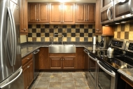 Vivos upscale gourmet kitchens feature stainless steel appliances and granite countertops with two of every appliance for backup operation.